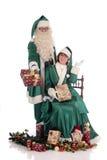 Santa Claus and Xmas woman Royalty Free Stock Images