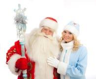 Santa Claus y doncella de la nieve Imágenes de archivo libres de regalías