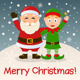 Santa Claus y duende de la Navidad en la nieve Fotos de archivo libres de regalías