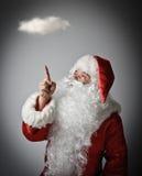 Santa Claus y nube foto de archivo