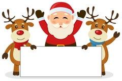 Santa Claus y reno con la bandera en blanco Imagenes de archivo