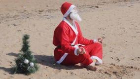 Santa claus yoga vacation holidays christmas new year. Chill stock video footage