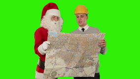 Santa Claus with a Young Architect reading a map, Green Screen, stock footage stock footage