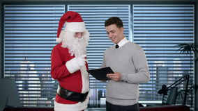 Santa Claus and Young Businessman in a modern office, stock footage