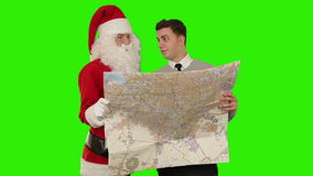 Santa Claus with a Young Businessman reading a map, Green Screen, stock footage stock video footage
