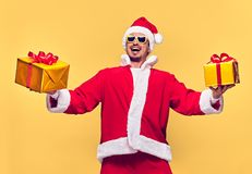 Santa Claus.Young Happy Santa Man, Christmas Gifts. Santa Claus. Young Happy Santa Man with Christmas Gift Boxes Presents Smiling. Handsome Fashion guy Having Stock Images