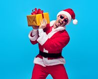 Santa Claus.Young Happy Santa Man, Christmas Gifts royalty free stock photos