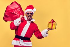 Santa Claus. Young Happy Santa. Sack bag Presents. Santa Claus. Young Happy Santa Man. Christmas Santa sack bag Presents gifts. Portrait Handsome Fashion guy stock image