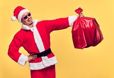 Santa Claus. Young Happy Santa. Sack bag Presents stock images