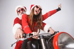 Santa Claus And Young Mrs Claus Riding A de Motorfiets royalty-vrije stock foto