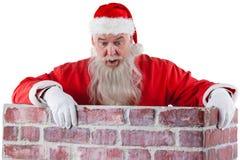 Santa Claus zerkanie nad ścianą Fotografia Stock
