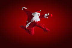 Santa Clause. Dancer Red background stock photos