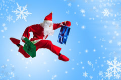 Santa Clause. Dancer blue background stock photos