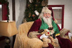 Santa Clause. Sitting in his chair at his place Stock Image