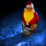 Santa Clause. Plastic santa clause in the snow at night Royalty Free Stock Image