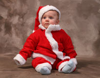 Santa clause baby. Baby in santa clause suit, traditional portrait of young toddler dressed as father christmas stock photo