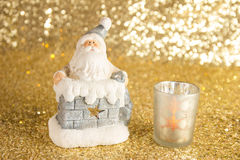 Santa Clause with bag of presents. In the pipe and candlestick Stock Images