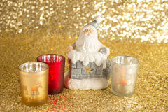 Santa Clause with bag of presents. In the pipe and candlestick Stock Photos