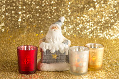 Santa Clause with bag of presents. In the pipe and candlesticks Stock Photography