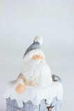 Santa Clause with bag of presents in the pipe. On the white background Stock Photo