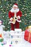 Santa Clause blowing Sax Stock Photography