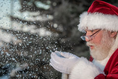 Santa Clause blowing snow Stock Photos