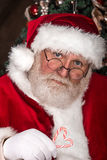 Santa Clause with candy cane Stock Photo