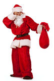 Santa Clause carrying a heavy sack Royalty Free Stock Photo