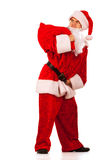 Santa Clause carrying a heavy sack Royalty Free Stock Photography