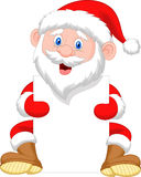 Santa Clause cartoon holding blank sign Stock Images