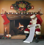 Santa Clause Checking His List Stock Photo