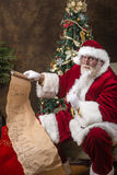 Santa Clause checking his list Royalty Free Stock Images