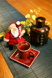 Santa Clause Chinese Style. Toy Santa with Chinese Tea set Stock Photo