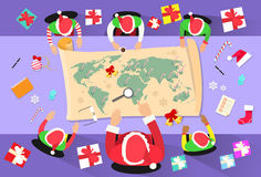 Santa Clause Christmas Elf Cartoon Character. Sitting Desk World Map Concept Flat Vector Illustration Stock Images