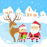 Santa Clause Christmas Elf Reindeer over Winter Stock Photo