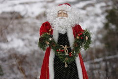 Santa Clause decoration. Holding garland stock photography