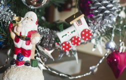 Santa Clause figure and a fragment of the Cristmas tree decoration Stock Photo