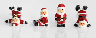 Santa Clause figurine isolated. Four funny Santa Clause figurine isolated on white Stock Photography