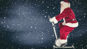 Santa clause on a fitness device combined with falling snow. Digital composite of Santa clause on a fitness device combined with falling snow stock video footage