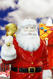 Santa Clause with a golden bell. Santa Claus ringing a golden bell to call for Christmas royalty free stock photo