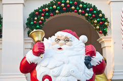 Santa clause with golden bell on hand Stock Photo