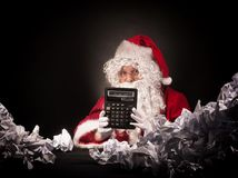 Santa clause with a great heap of crumpled papers. Royalty Free Stock Images