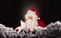 Santa clause with a great heap of crumpled papers. Royalty Free Stock Photography