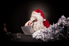 Santa clause with a great heap of crumpled papers. Royalty Free Stock Photo