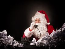 Santa clause with a great heap of crumpled papers. Stock Image