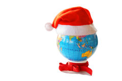 Santa Clause hat on a globe Stock Images
