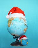 Santa Clause hat on a globe Royalty Free Stock Image