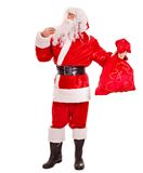 Santa Clause holding gift. Stock Photo