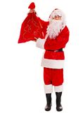 Santa Clause holding gift. Royalty Free Stock Image