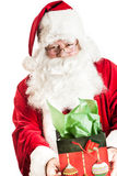 Santa clause holding a gift Stock Photography